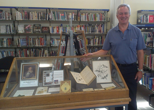 Chairman of the Friends of Summertown Library, Marcus Ferrar, with the display at Summertown Library